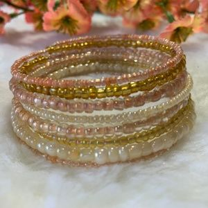 Cream, pink, and gold beaded bracelet